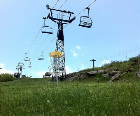 Disc golf tee located below the chair lift at Beech Mountain Resort.