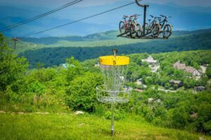 Disc Golf Basket with Mountain View in background.